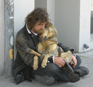 homeless man with his pet dog