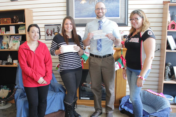 Centennial College Students present fundraising cheque to Oasis Animal Rescue staff